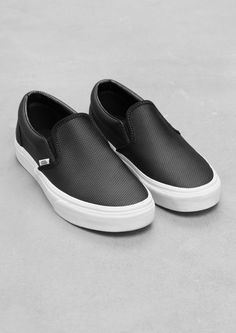 vans black perforated leather slip on
