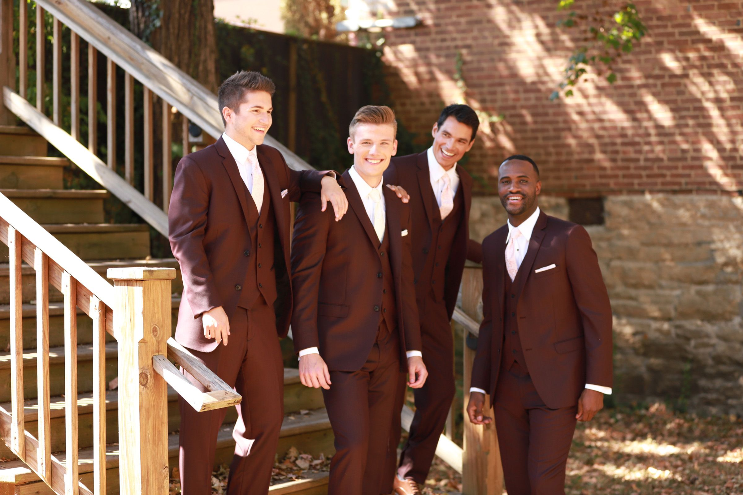 All the guys will love the Burgundy Suit Rental for your