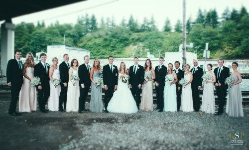 Bridesmaids Dresses In A Mix Of Mint Blush Grey Creams And Groomsmen Clic Black Suits Bridal Bliss Wedding