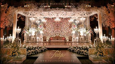 Gorgeous peach and white wedding flowers stage decoration setup gorgeous peach and white wedding flowers stage decoration setup crystal backdrop hanging chandeliers junglespirit Image collections