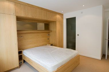 Bedroom On Bedroom Featuring A Large Built In Wardrobe Around The Bed  Giving A