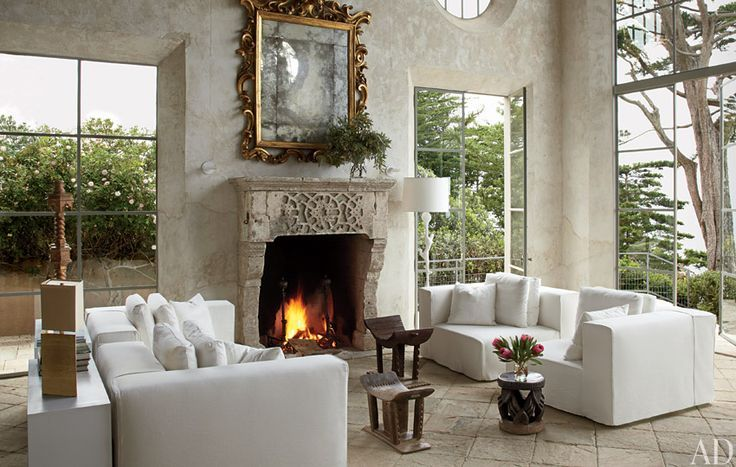 A getaway on Malibu's Broad Beach renovated by Richard Shapiro . Mediterranean influence, sanded frescoed walls and an eclectic antique fireplace mantle by Ancient Surfaces.   www.AncientSurfaces.com Phone: 212-461-0245