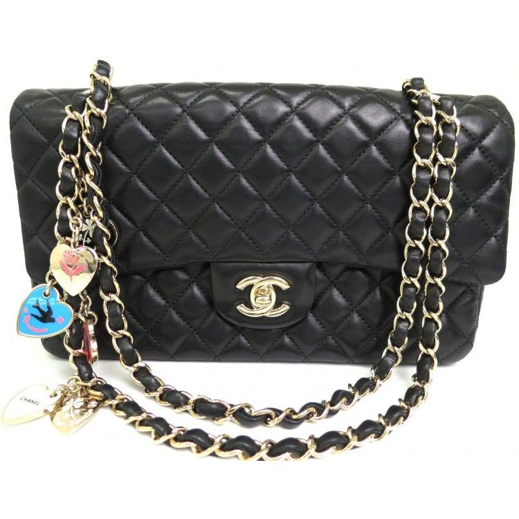 ab07c2c71aac This authentic CHANEL Classic Flap is finely crafted from black quilted  lambskin. The interior opens