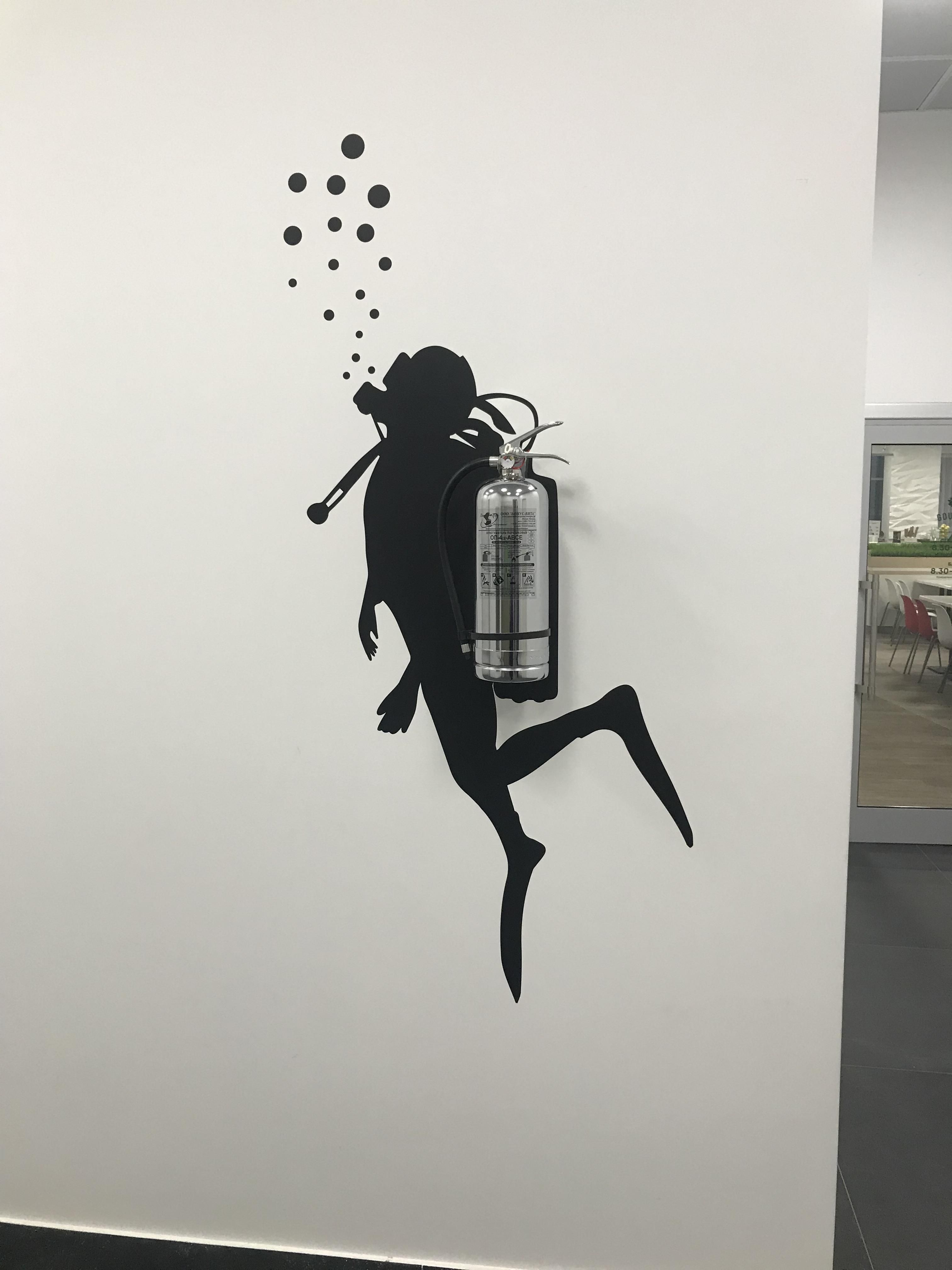 This fire extinguisher wall decal that looks like scuba