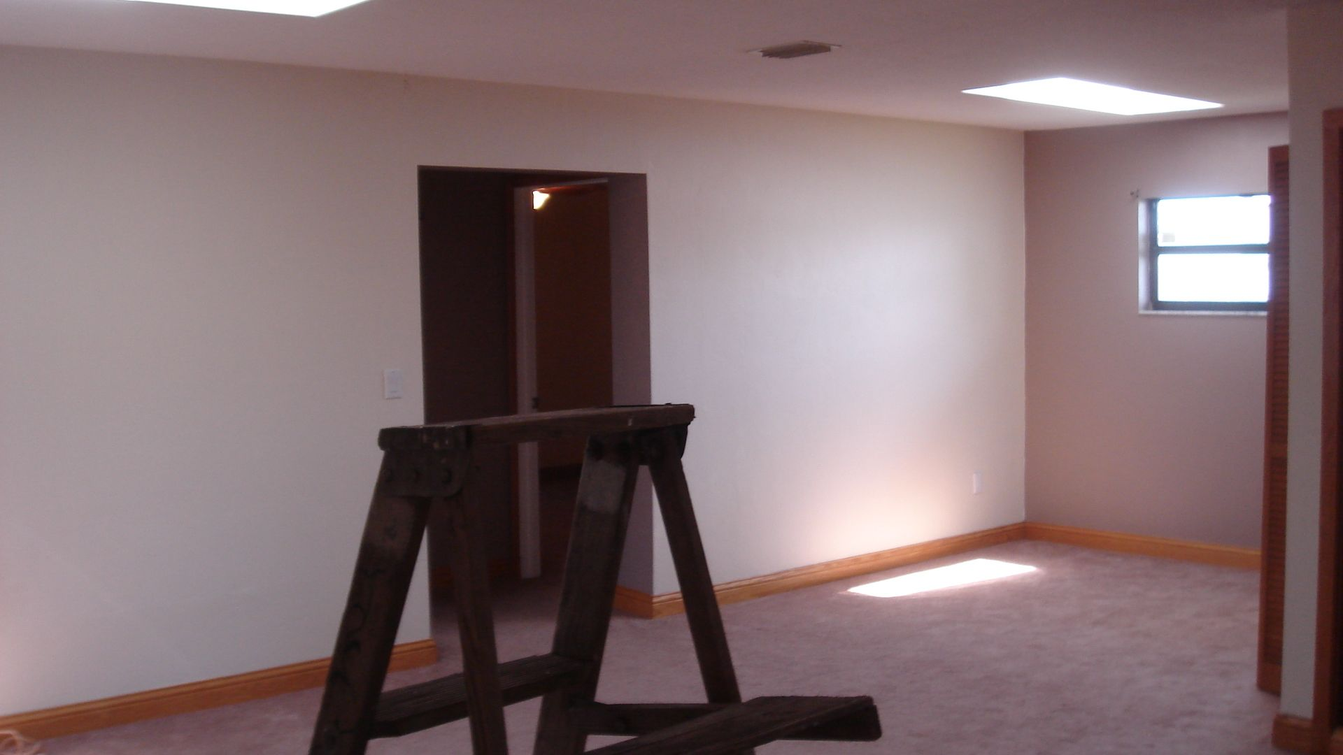 Family room area with carpet prior to remodeling