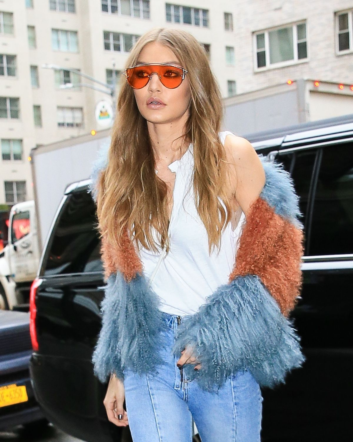 cbbfa710db Orange on Orange Sunglasses coordinated outfit Gigi Hadid Sunglasses 2017