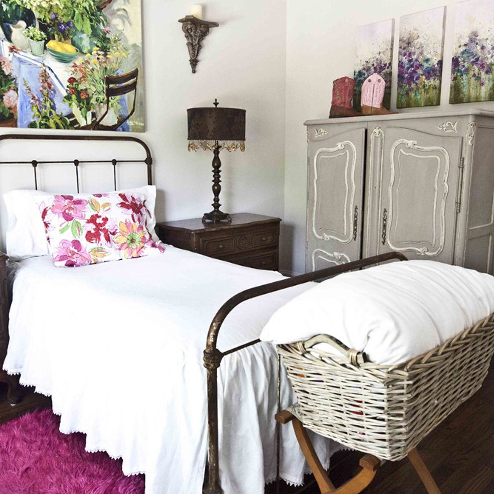 Antique french iron bed - Antique Iron Bed With Large Colorful Artwork Pair With Vintage French Armoire To Give The Room
