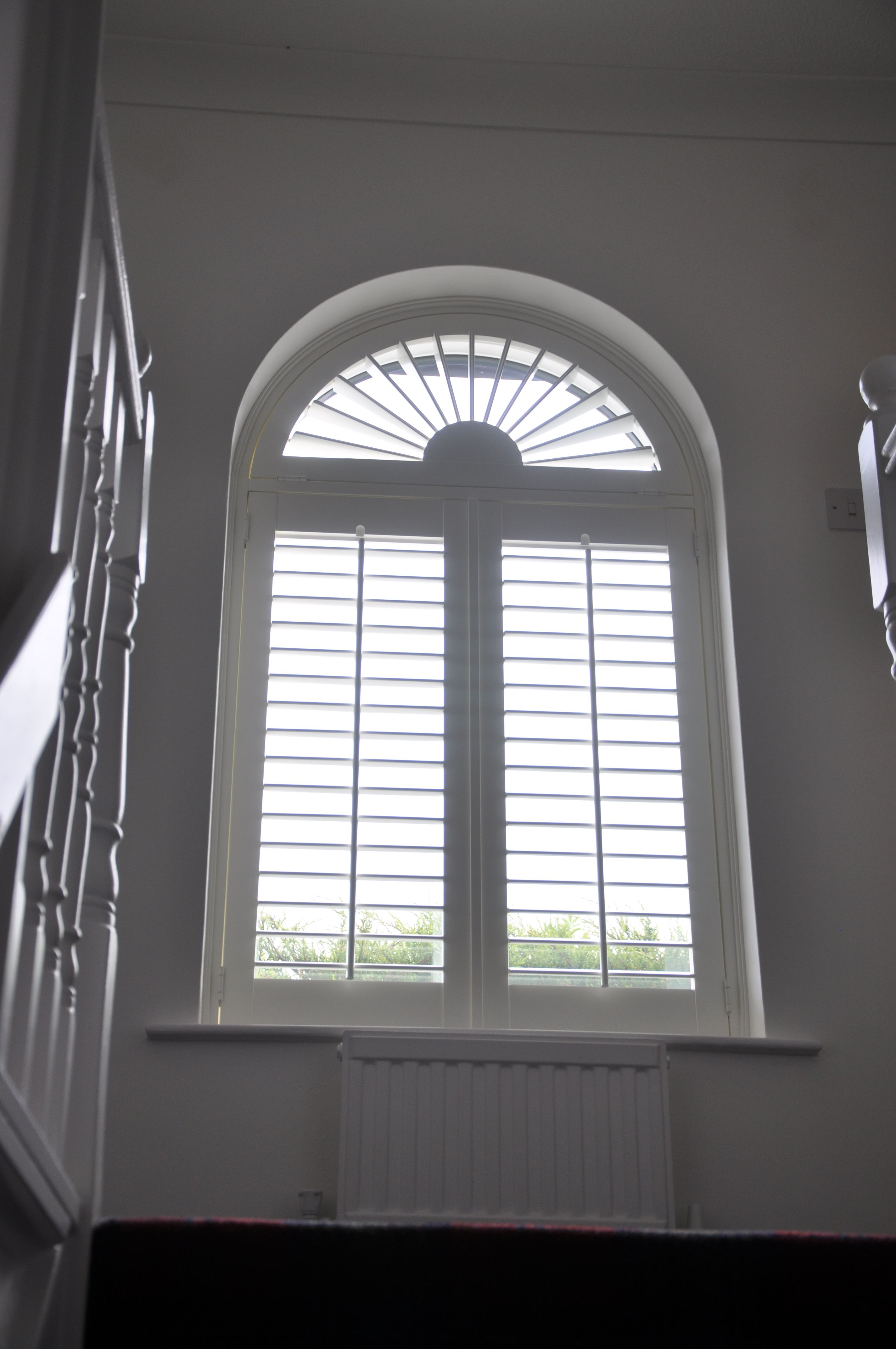 Beautifully shuttered fitted this arched shutter in