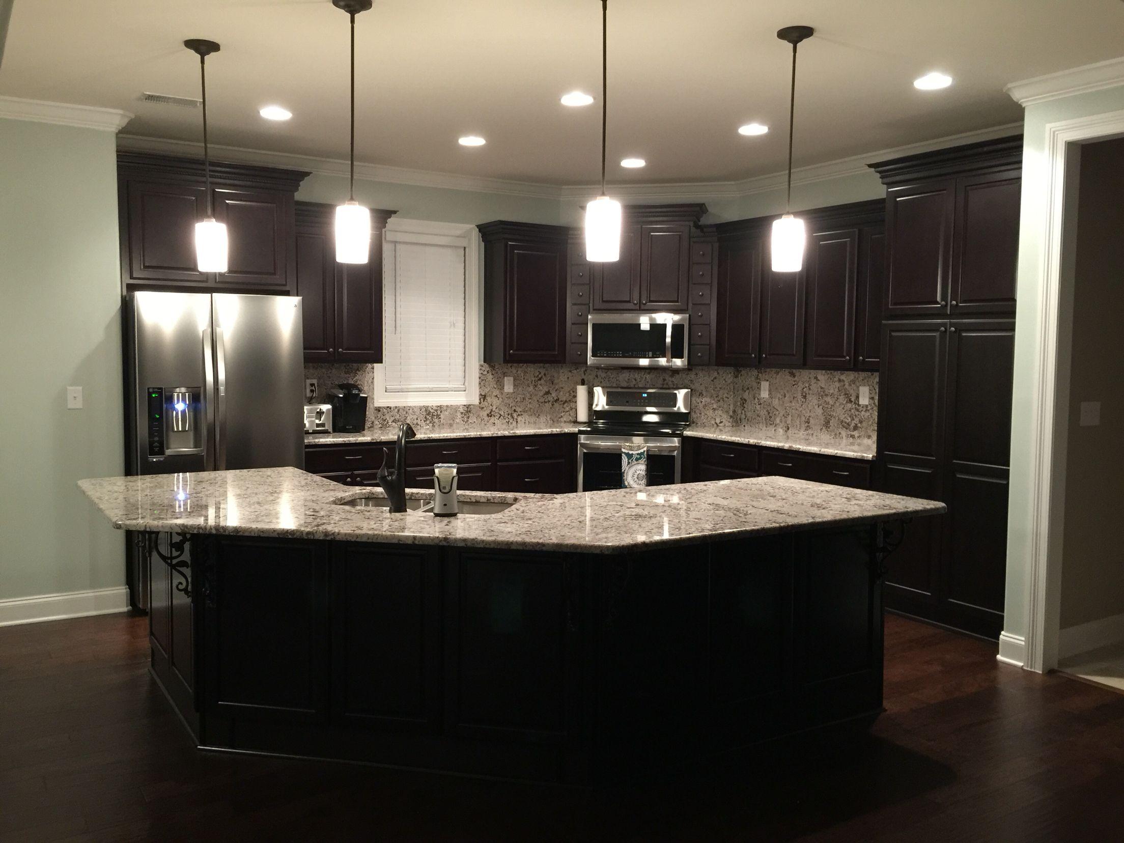 Kona Cabinets, Bonita Antico Granite Backsplash, Sherwin Williams Sea Salt  Paint, And Hardwood