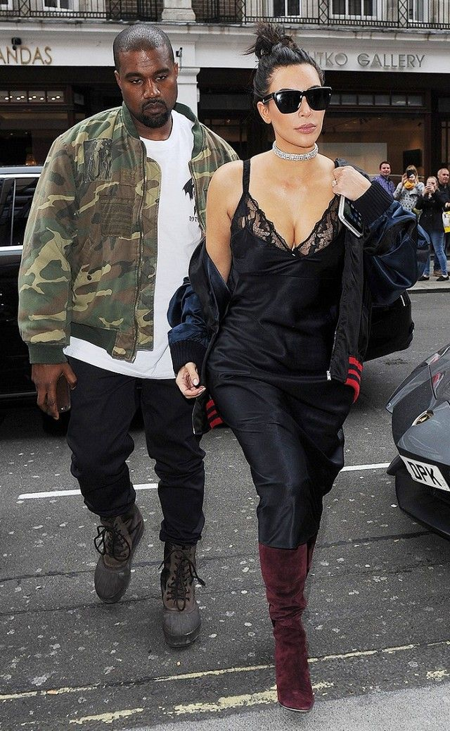 9b4c4e90f Kim Kardashian steps out with husband Kanye West in a silk black midi  dress, over the knee boots and a bomber jacket