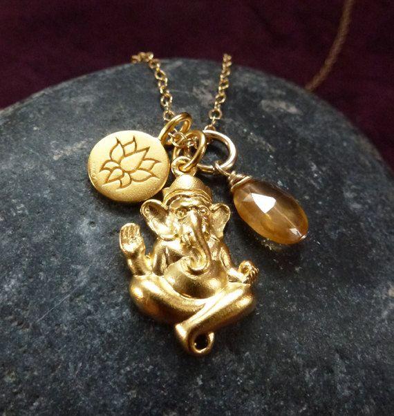 Ganesh 24k gold plated ganesh pendant with lotus charm and ganesh 24k gold plated ganesh pendant with lotus charm and hessonite garnet 8000 via etsy aloadofball Choice Image