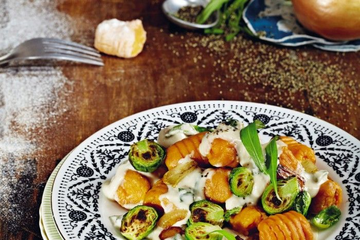 We love Isa Chandra Moskowitz and her irreverent vegan ways. The Brooklyn native is the creator of the Post Punk Kitchen and author of killer vegan cookbooks such as Vegan Cupcakes Take Over The World. Here, she shares one of her decadently delicious vegan delights with us—Sweet Potato Gnocchi with Seared Brussels Sprouts. Enjoy! [Photo: Vanessa Rees] http://www.womensmovement.com/good-eats-sweet-potato-gnocchi/