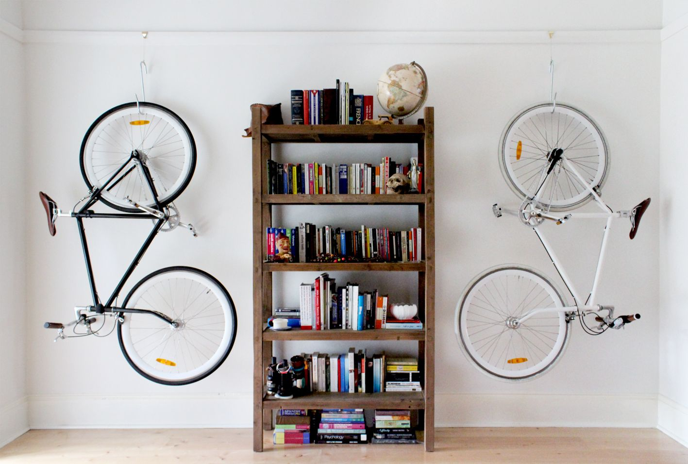 Look jeremy s bicycle rack apartment therapy - Picture Perfect Bike Storage Utilizing Picture Hooks In Living Room