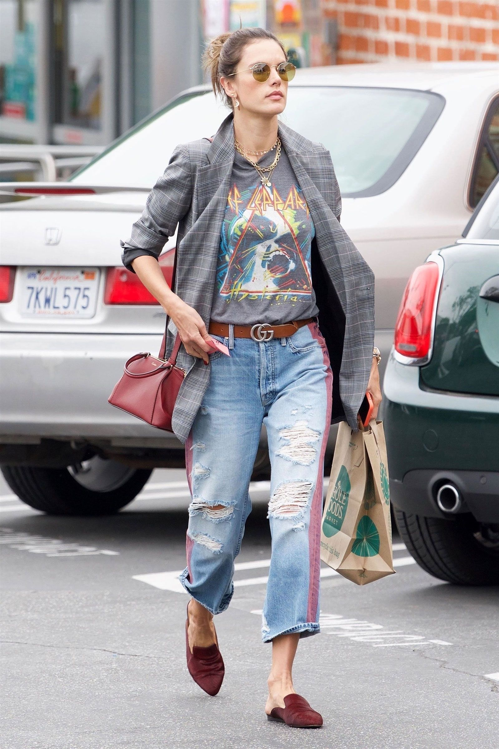c28d6837ff9 Alessandra Ambrosio Elevates Her Band Tee with A Blazer and Mules ...