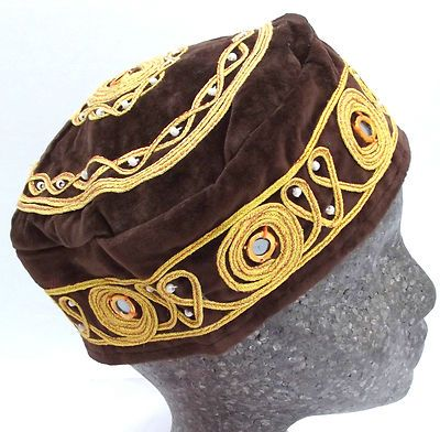 A traditional Turkish smoking hat decorated with gold braiding