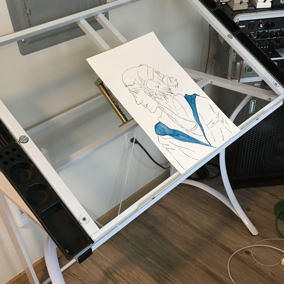 I got a glass topped artist desk that inclines on