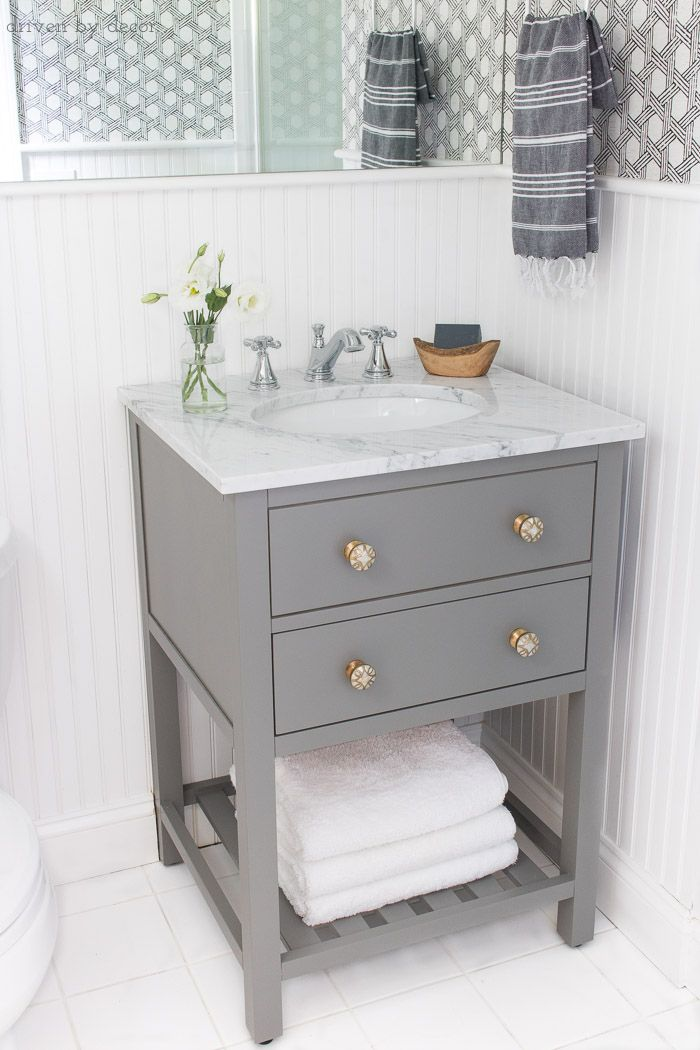 Small space single sink gray vanity with white marble top and