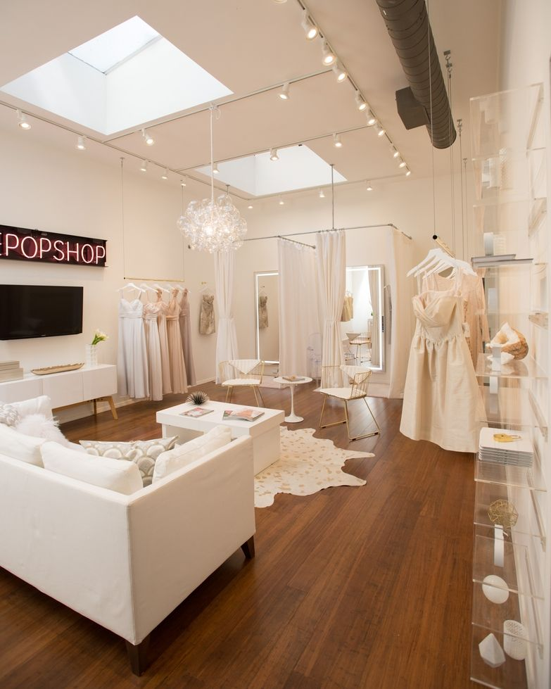 A peek inside a luxe feminine bridal salon designed on a for Interior designs of boutique shops