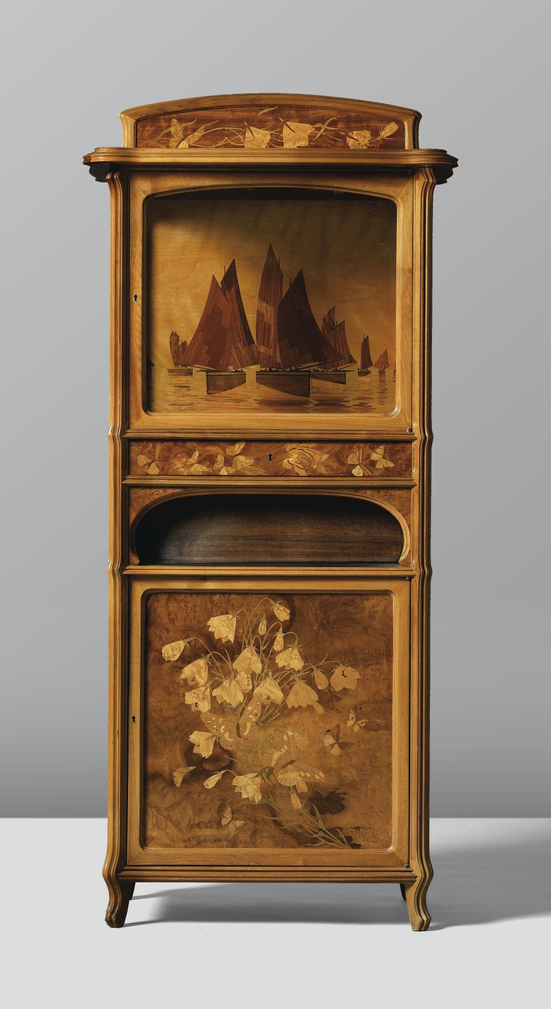 a walnut cabinet with fruitwood marquetry inlay by emile gall circa 1905 art furniture i. Black Bedroom Furniture Sets. Home Design Ideas