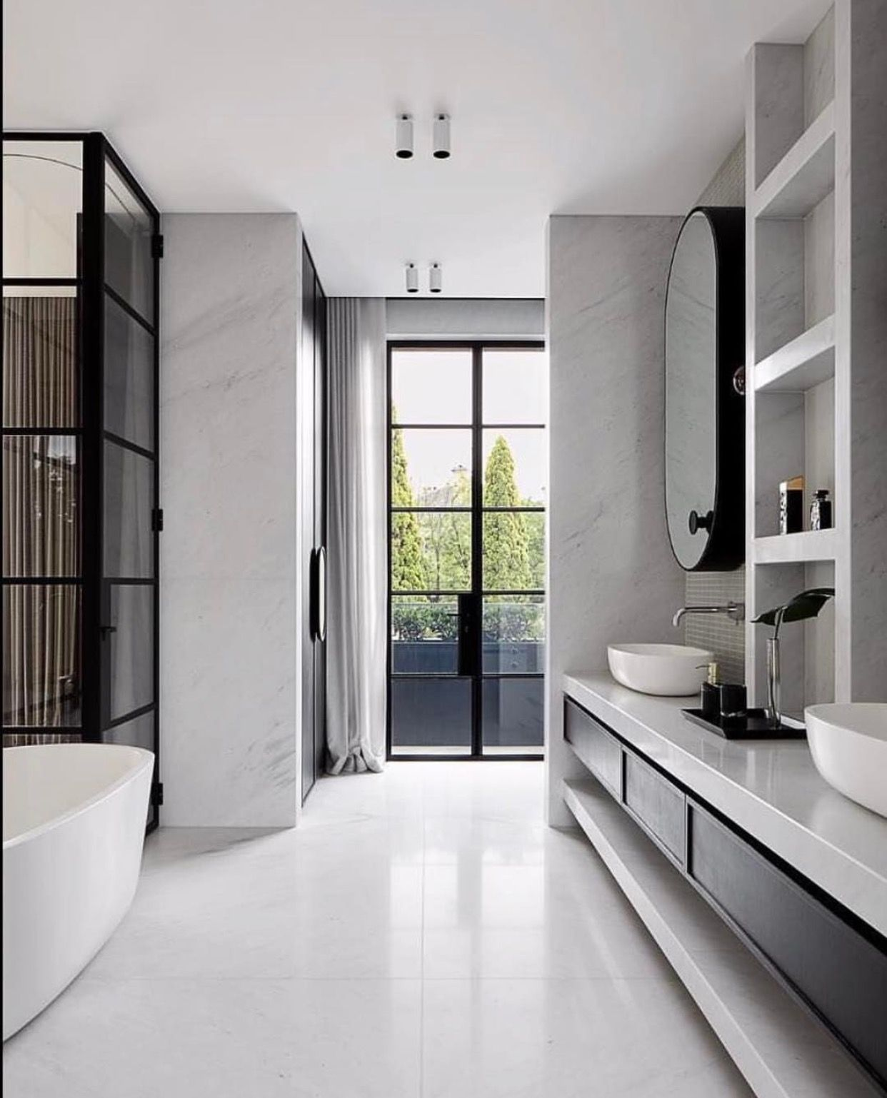 INSPIRATION: Curved Edges And Clean Lines In This Chic Bathroom Are A  Winning Combination With Black Steel Framed Doors.