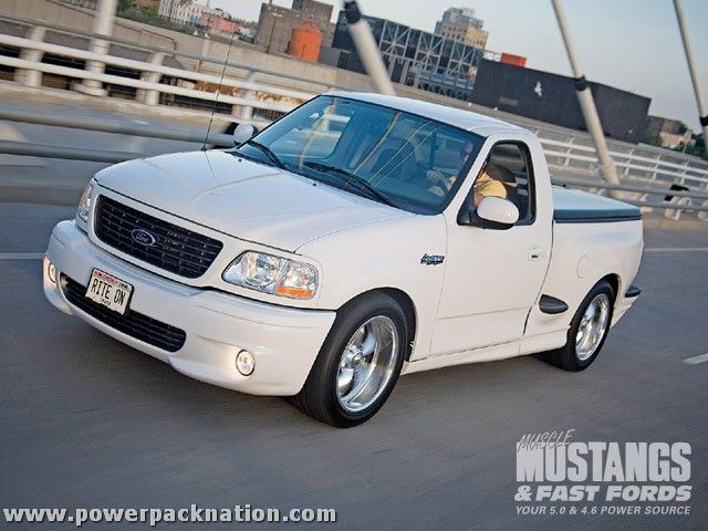 This Ford Lightning was photographed by Optima Jim and appeared in Muscle Mustangs & Fast Fords magazine.  This photo was taken on the 6th Street bridge in downtown Milwaukee, with the Harley-Davidson museum in the background. The truck's most-unique attribute is it's custom-made manual transmission.