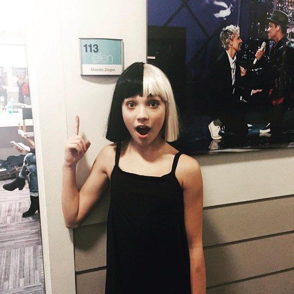Maddie Ziegler after performing for Sia in black and white wig 74c35ce8ec41