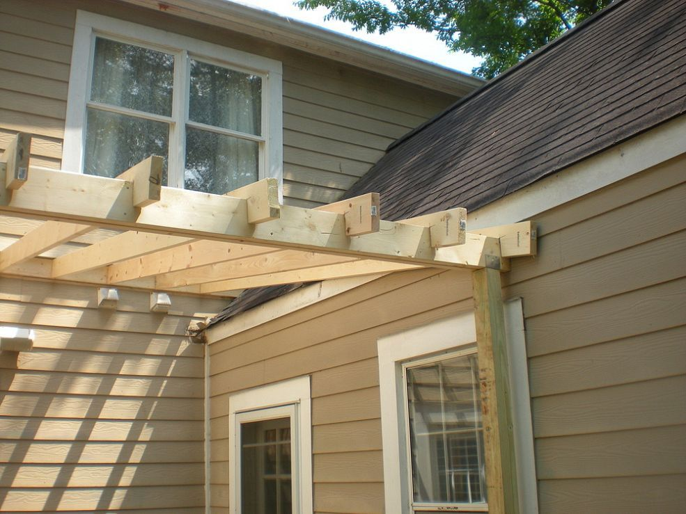 new roof over deck with columns and beadboard ceiling