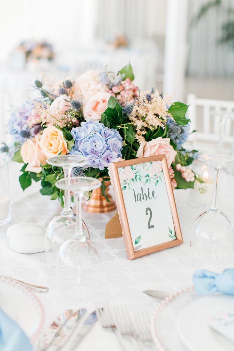 Light blue wedding decoration ideas  flower centerpiece blush pink and light blue flowers copper