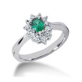 eb4fbba558b9 El anillo con esmeralda y diamantes IBAGUE es un anillo montado en oro  blanco de primera ley con una esmeralda central oval de 6 4 mm rodeada de  0
