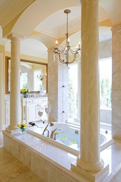 Grand Bathroom - columns surrounding soaking tub, like a Roman bath. Not  that I think I will ever have a bathtub this amazing but it would be nice