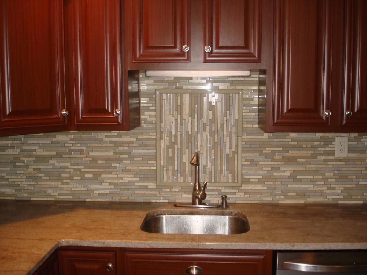 Glass and stone linear backsplash with accent Backsplash Designs