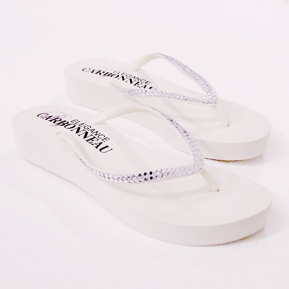 557be52c9a17 A wedding on the beach or outdoors calls for practical bridal shoes like  these Crystal Rhinestones Low Wedge  Bridal  FlipFlops.