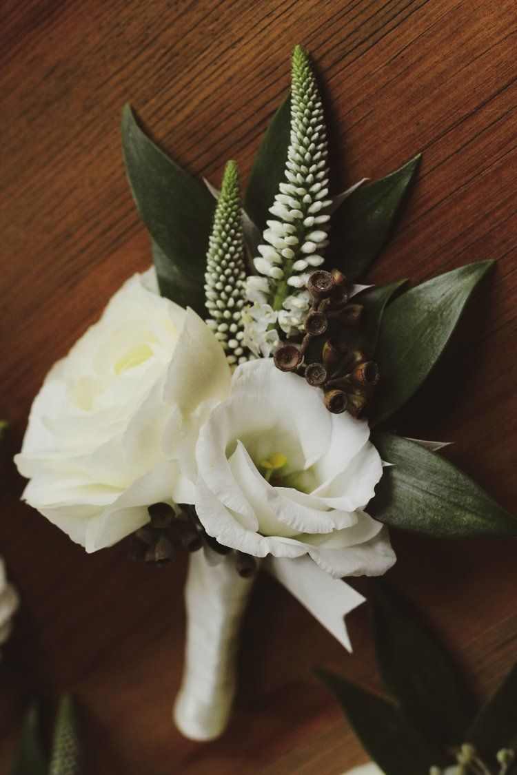 White Ranunculus And Lisanthus Grooms Boutonniere With Seeded Eucalyptus And Veronica Roots Wild White Ranunculus Ranunculus Boutonniere Ranunculus Bouquet