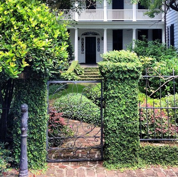 A hitching post marking the entrance to a lovely Charleston garden