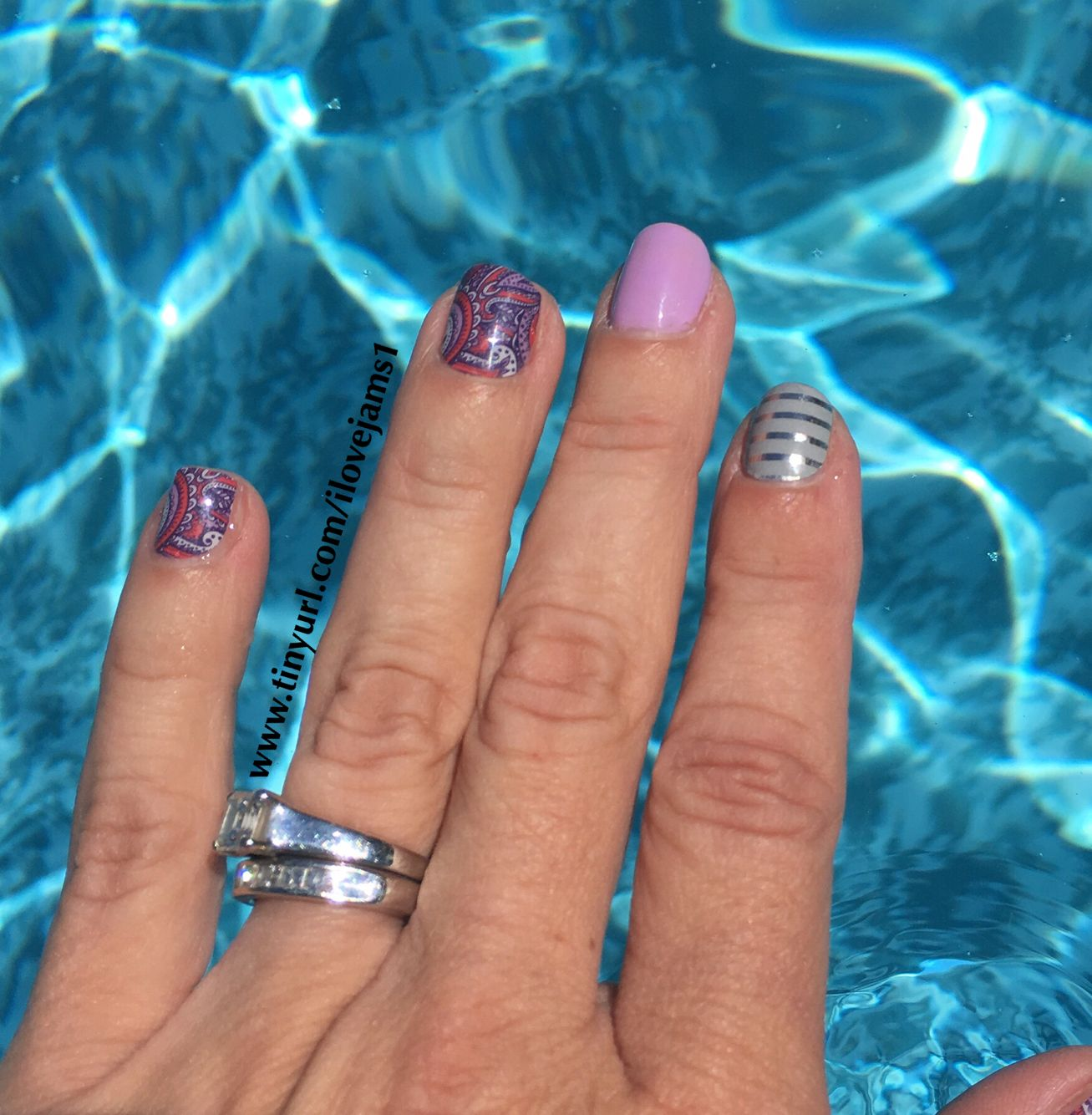 Swimming all day and my Jamberry nails still look gorgeous! #shesunavailablejn #junehejn #grayandsilverhorizontalstripejn