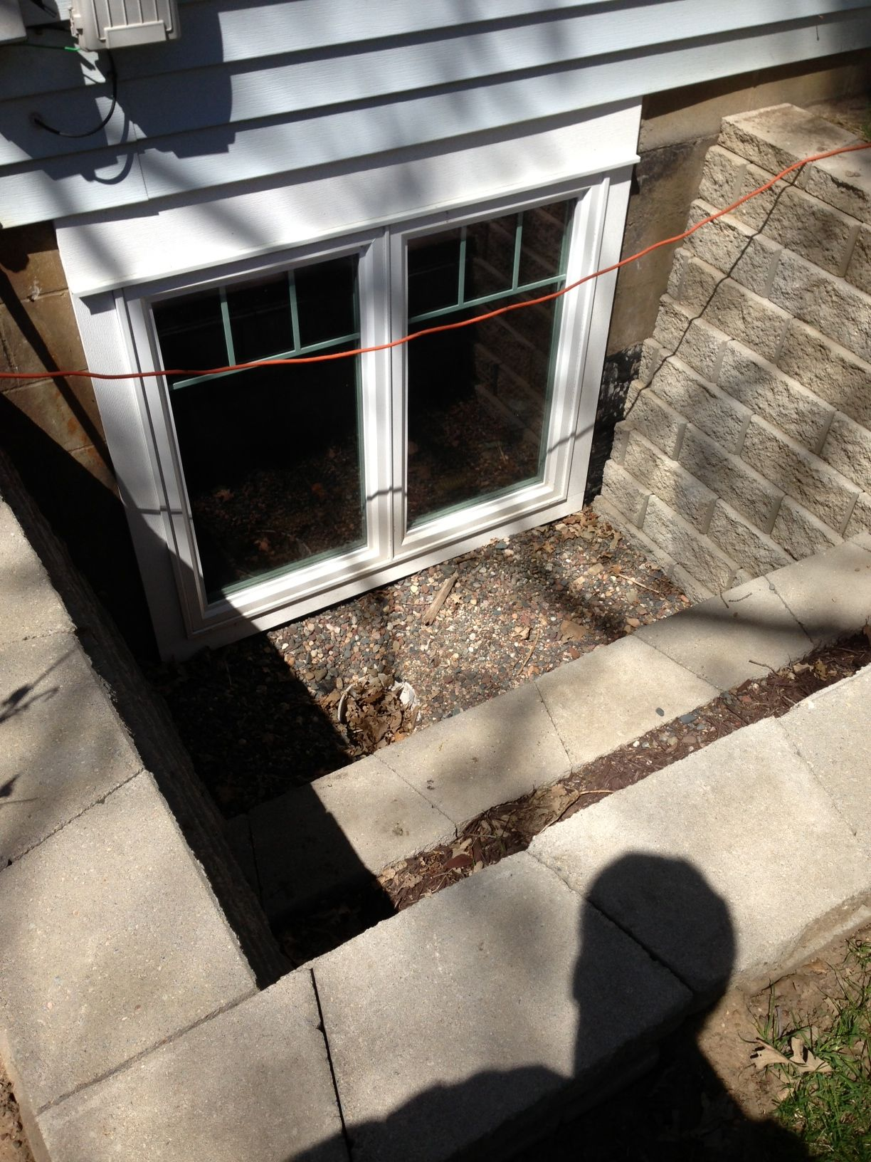 Older install    Double with stone well Affordable Egress