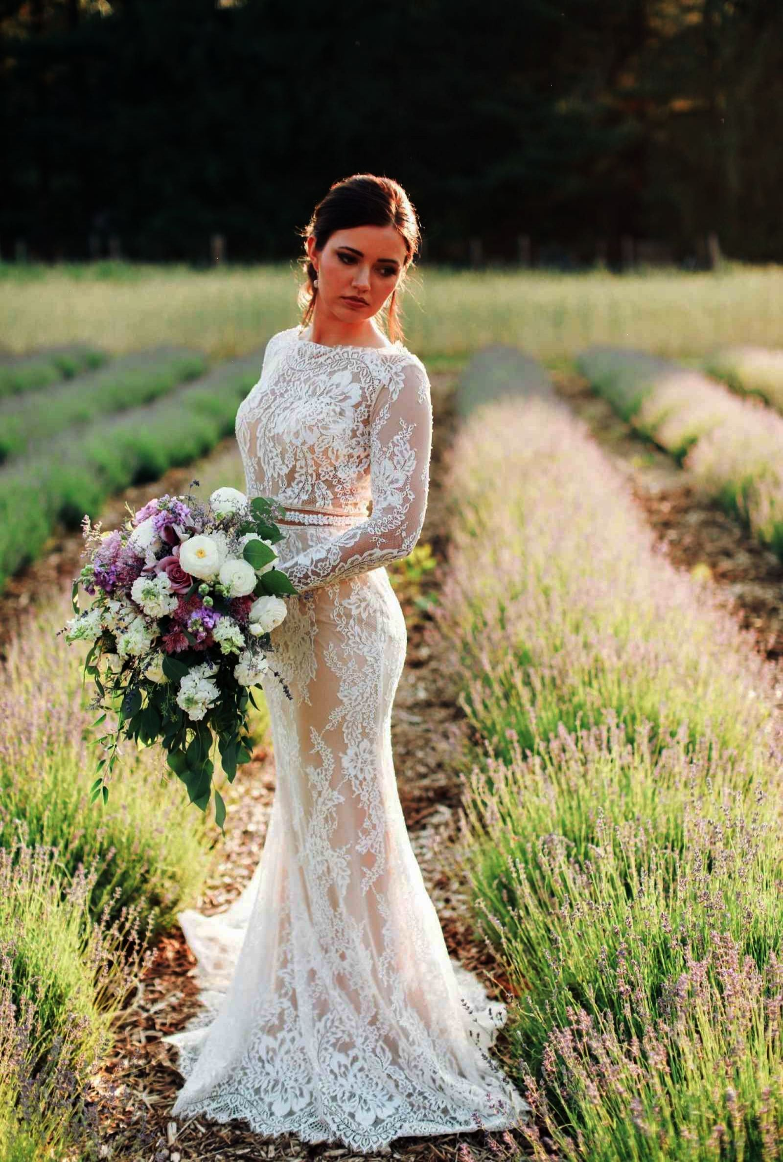 Long sleeve lace wedding dress with cascading purple and white