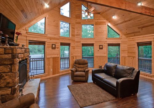 Cabin with vaulted ceiling in living room. Yes, please!
