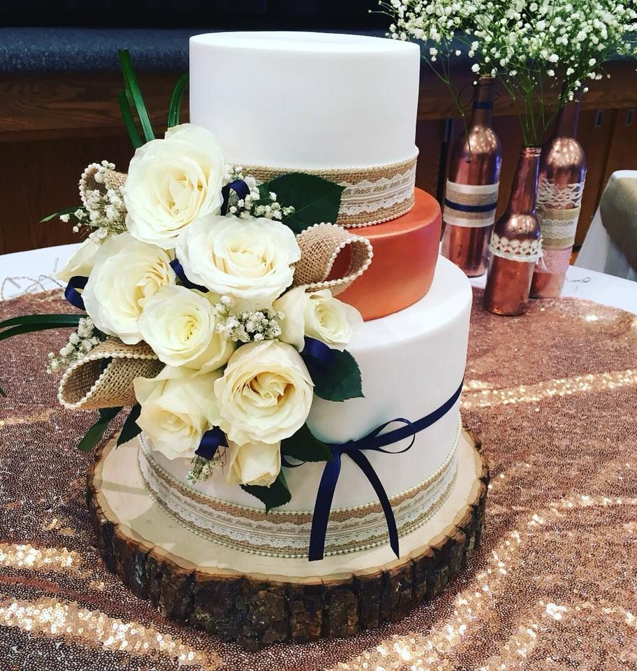Rose gold and fresh florals make this wedding cake extra
