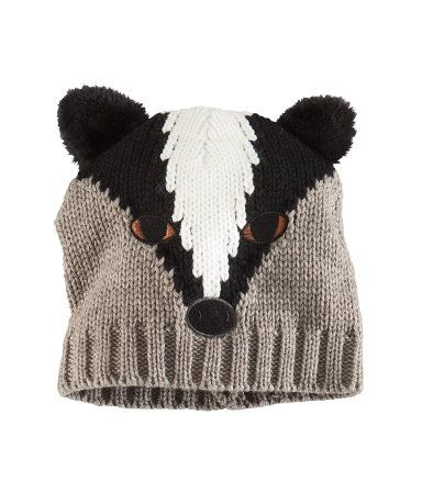 76e6beeab3a Knitted hat with an embroidered animal face.