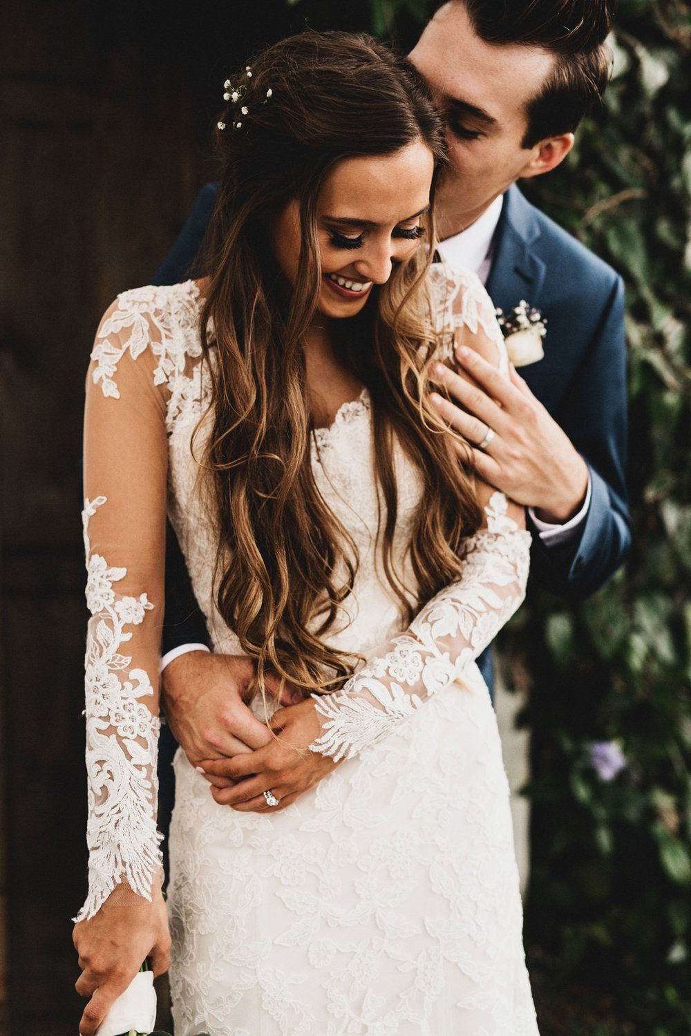 Vintage florida wedding featuring a long sleeve lace wedding dress