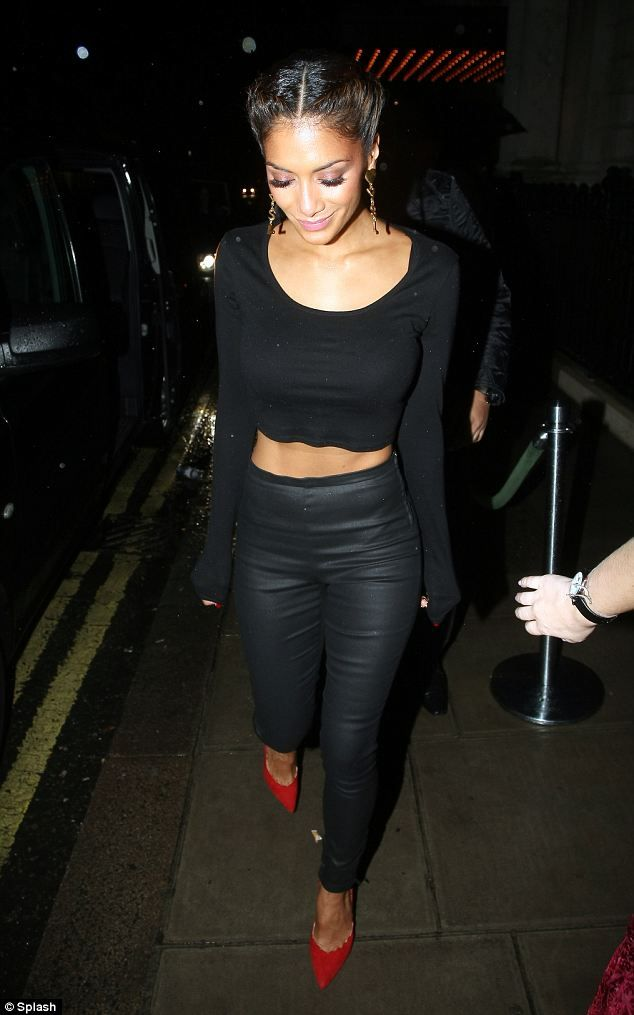 a long-sleeved crop top teamed with leather trousers.
