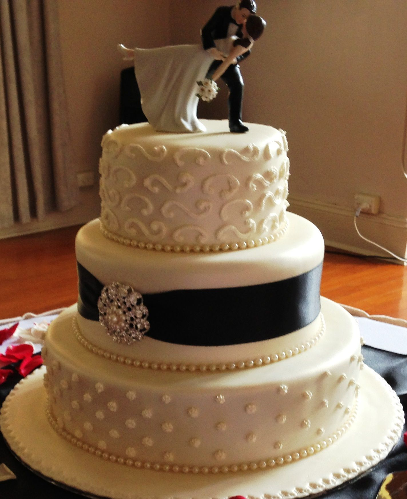 Tier round wedding cake black and white destination
