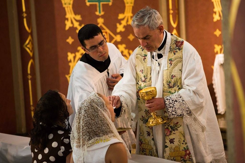 Photo receiving Holy Communion at the Ordinations in St