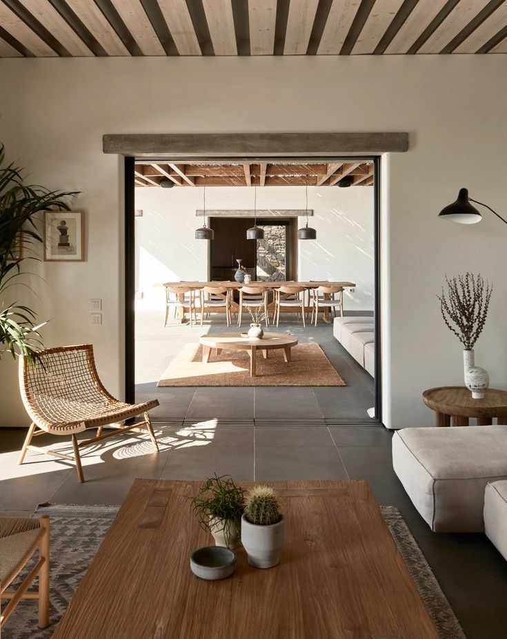 Look inside Villa Mandra, a summer home high on a hill in Mykonos, Greece. A breezy open air mix of stone, sun & salt air. Get the summer home style guide! #homedesign #homedecor