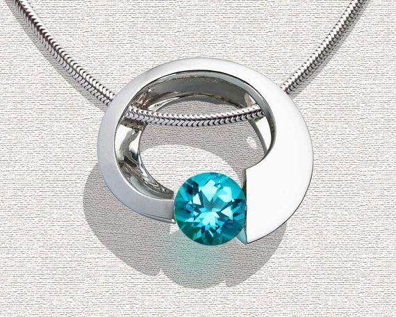 Argentium silver and blue topaz pendant designed by David Worcester for VerbenaPlace.Etsy.com