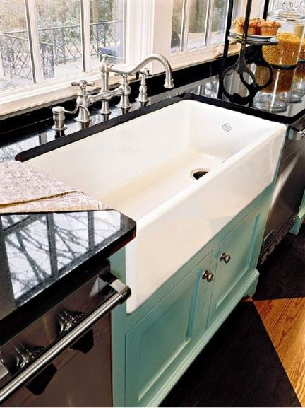 I like this large kitchen sink and how the garbage disposal is on