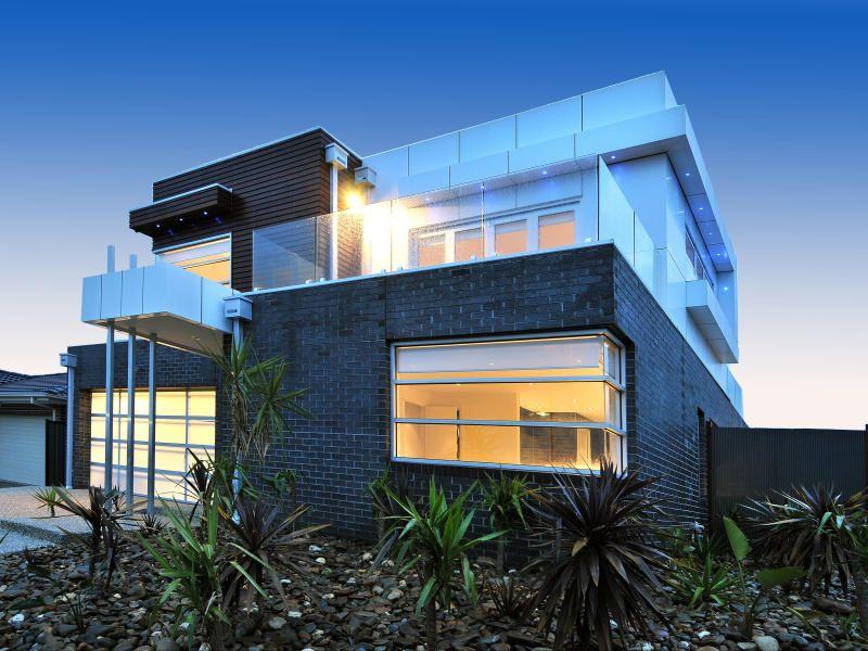 Modern Facade brick modern house exterior with balcony & landscaped garden