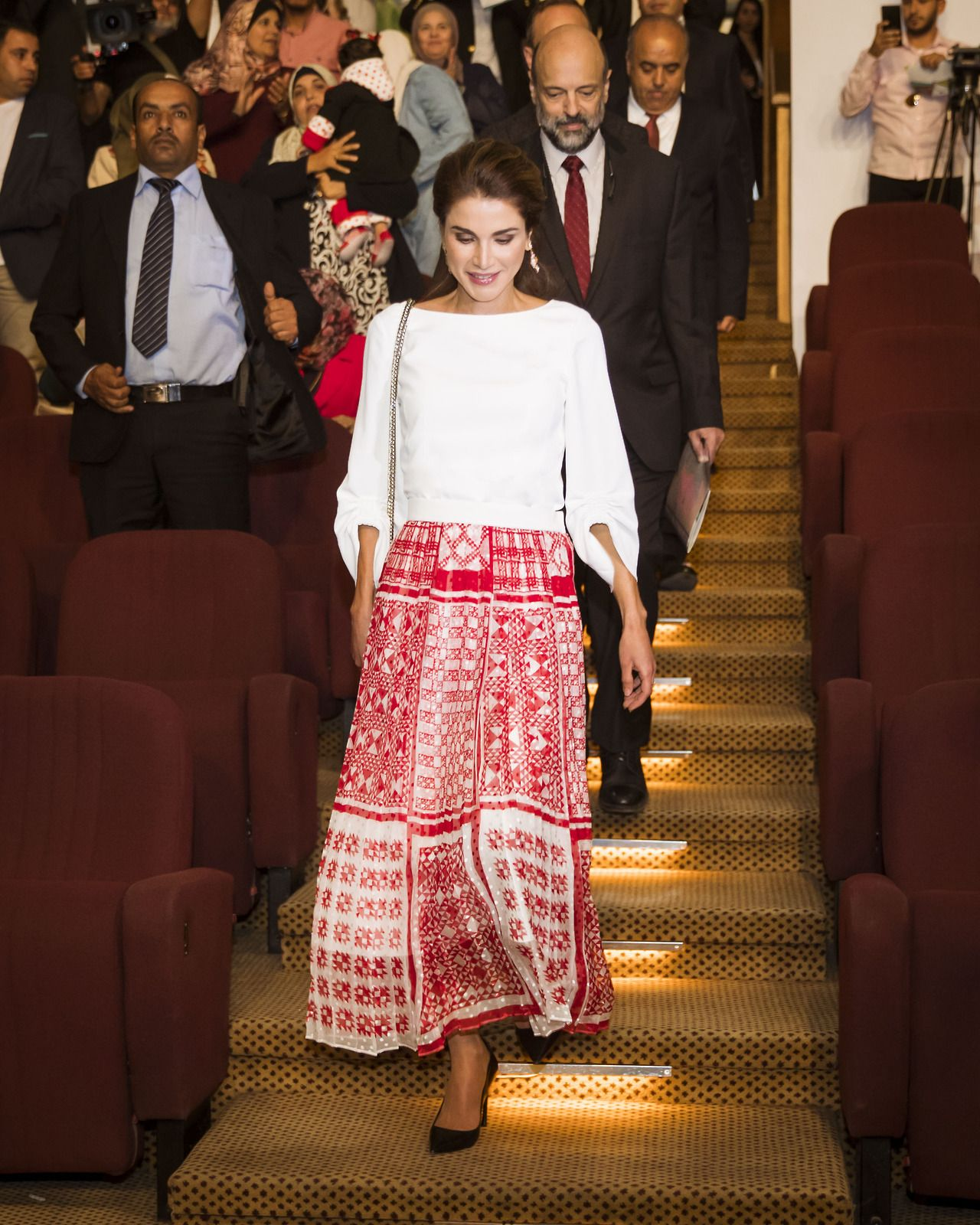 16 October 2017 - Queen Rania attends diploma presentation ceremony at the Queen Rania Teacher Academy in Amman - blouse by Tibi, skirt by Fendi, shoes by Dior