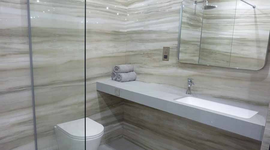 a luxury hotel shower room created by porcel thin featuring fiora furniture and marmara equator marble effect thin porcelain tiles